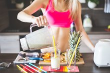 Fitness Girl Preparing Smoothie