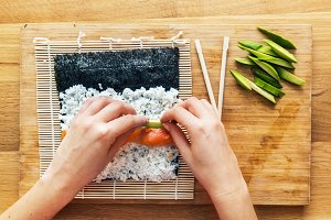 Preparing sushi. Wooden table.