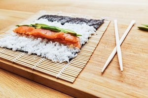 Preparing sushi on wooden table.