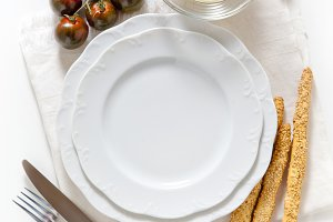 empty plate, cherry tomatoes