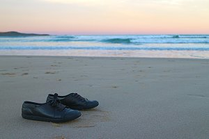 Shoes at the beach during sunset