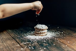Sprinkling sugar on cookies