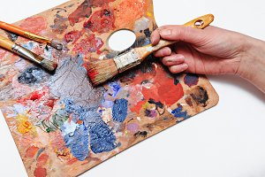 Hand with brushes and palette