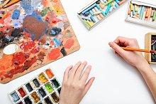 Artist's hand at work. Pencils