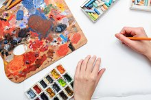 Pencils. Artist's hand at work.