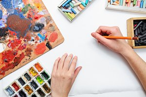 Pencils. Artist's hand at work.