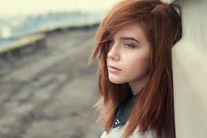 sad red-haired girl
