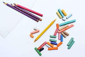 Colored crayons and pencils closeup