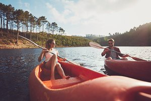 Young couple kayaking on a lake