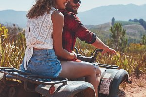 Young couple enjoying a quad bike