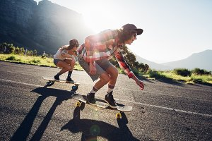 Young friends longboarding