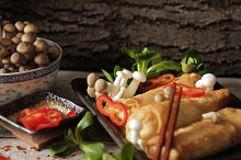 Japanese food style. Fried spring rolls with vegetables and shimeji mushrooms