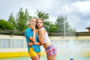 Best girlfriends near fountain.