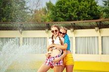 Teen girl in sunglasses hugging.