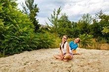 Best girlfriends sitting on sand
