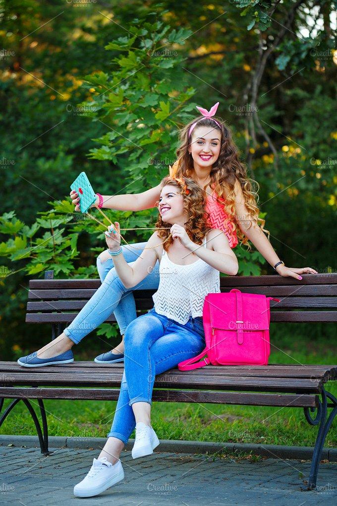 Best girlfriends on bench. Selfie - People