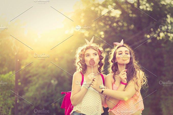 Best girlfriends lollipops. Sunset. - People