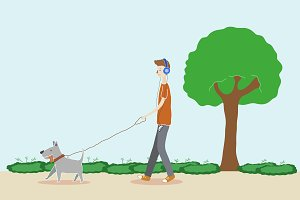 Boy walking the dog in the park