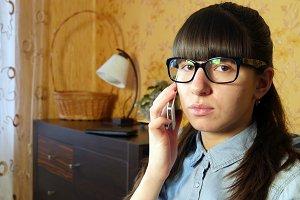 Joyful young woman talking on phone