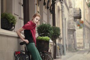 red-haired girl with a bicycle