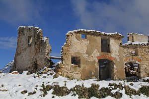 Abandoned houses in snow