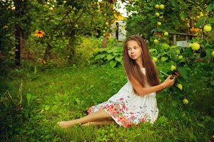 Teen girl in garden. Summer