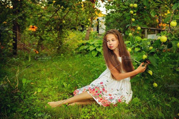 Teen girl in garden. Summer - People