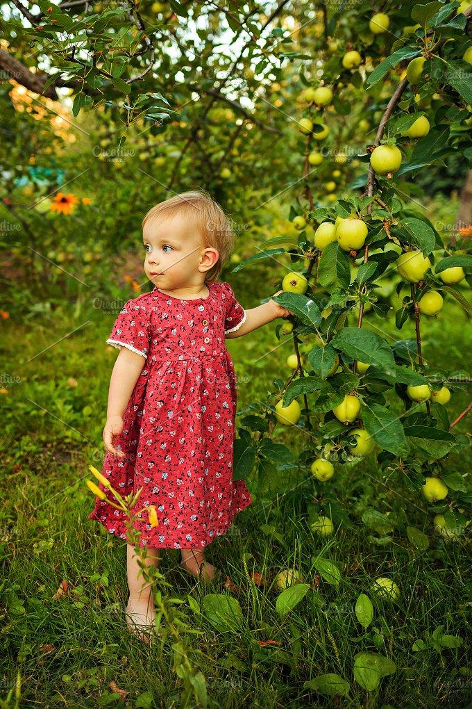 Little cute girl in garden. Summer - People