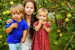 Sisters and brother in garden
