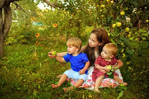 Sisters and brother in summer garden