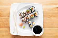 Sushi served with wasabi and ginger.