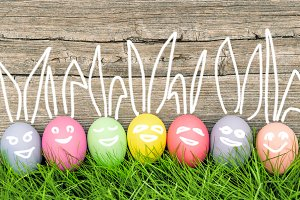 Funny bunny smiling easter eggs