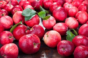 Group of red apples with their leave