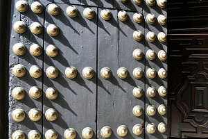 old door with golden brass nails