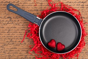 Frying pan with red hearts