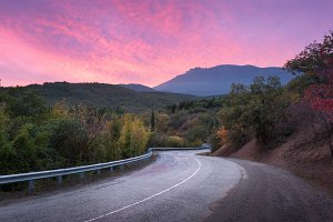 Mountain winding road at sunset