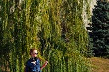 Ballet dancer hipster. Autumn park
