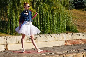 Ballet dancer hipster. Autumn park