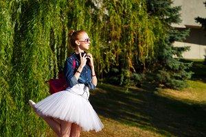Cute ballerina hipster. Summer park
