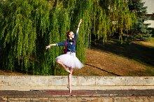 Ballerina hipster dancing in park