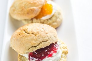 Scones with cream and fruit jam
