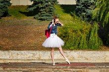 Ballerina hipster dancing on street