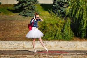 Ballerina hipster dancing on street