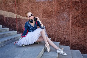 Ballerina hipster sitting on stairs