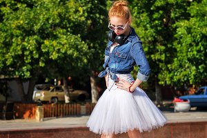 Hipster ballerina dancing on streets