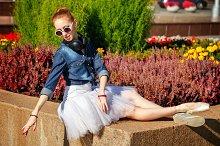 Ballerina resting in park.