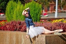 Hipster ballerina resting in park.