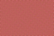 Abstract background of brown dots on red background
