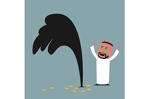 Arab businessman standing near oil