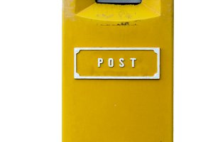 Yellow postbox isolated